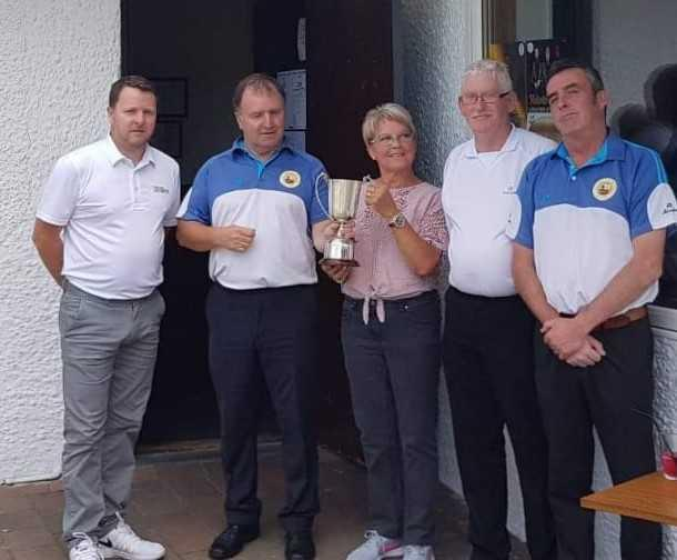 Saltcoats Bowling Club's open pairs tournament sponsored by Gerry's Taxis: Jim O`Hare and John Paton, winners, with runners-up Scott Bradley and Brian Fleming and trophy presenter Mary Barnett.