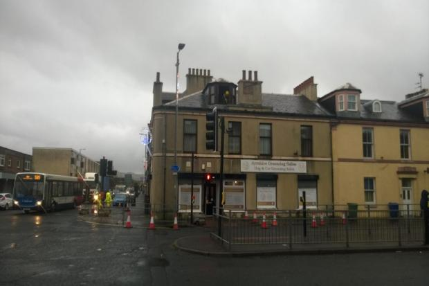 Stormy winds and rain batter Ardrossan building causing chimney to crumble