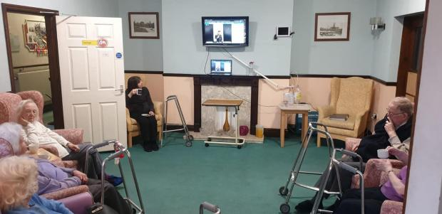 Ardrossan and Saltcoats Herald: Care home residents enjoy an Elvis tribute live stream.