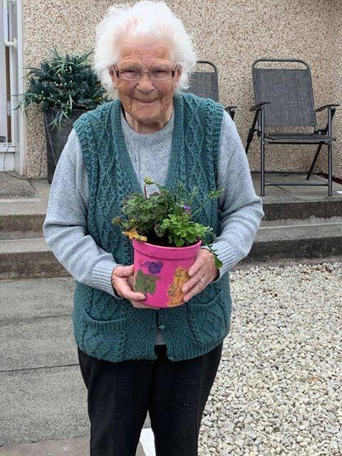 Ardrossan and Saltcoats Herald: Resident pleased to receive a special plant pot.