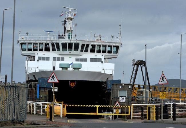 Two people were discovered in the rear footwells of a car on the ferry from Arran to Ardrossan.