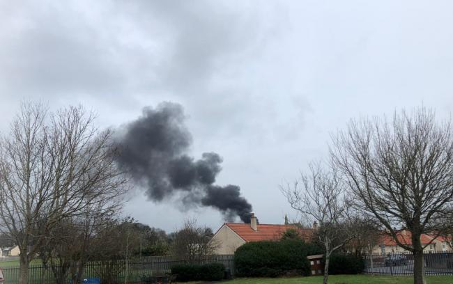 Thick black smoke billows across Kilwinning as crews tackle fire