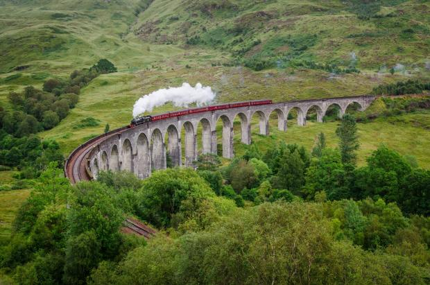Ardrossan and Saltcoats Herald: View of a steam train on a famous Glenfinnan viaduct, Scotland; Shutterstock ID 154641122; PO: THE HERALD MAGAZINE ; Job: TRAVEL