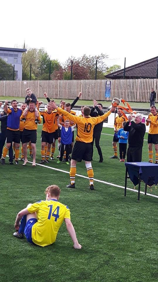 SILVERWARE SUCCESS: West Kilbride captain Scott Adam is pictured lifting the trophy.