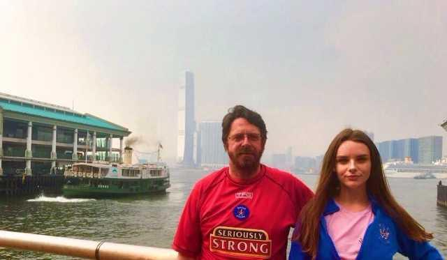 KILLIE CAMPAIGN: Stephen Hammill with his daughter Rhianna at Victoria Harbour in Hong Kong.