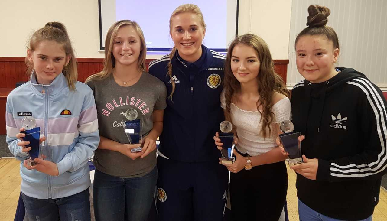 TOP PLAYERS: The Clark Drive Girls U13 award winners receive their prizes from Megan Cunningham (centre).