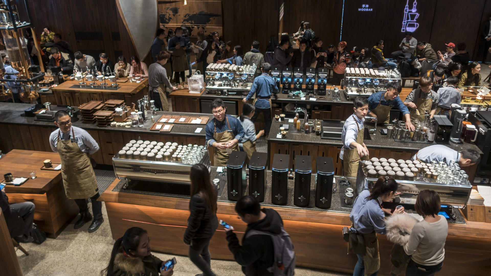 Staff work at the Starbucks Reserve Roastery in Shanghai, China (Chinatopix via AP)