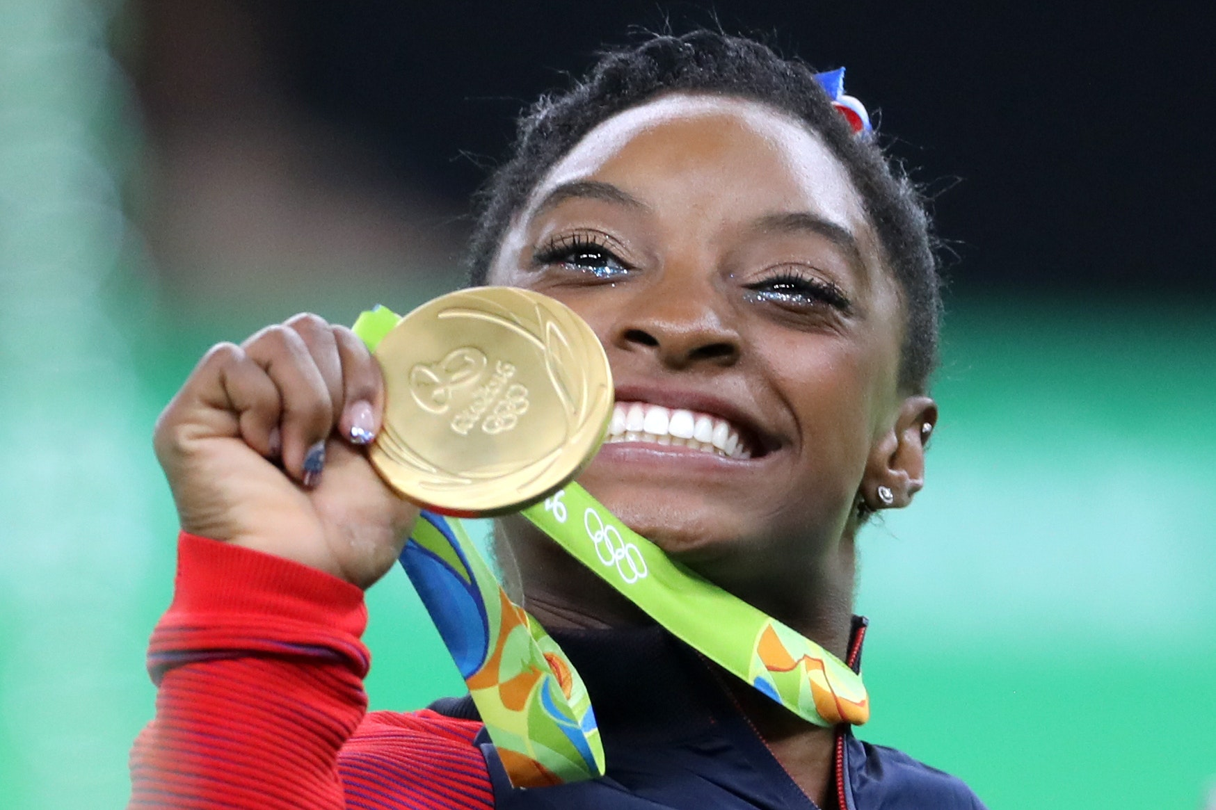 Simone Biles celebrates victory in the Women's Team Gymnastics final at the Rio Olympic Arena (Owen Humphreys)
