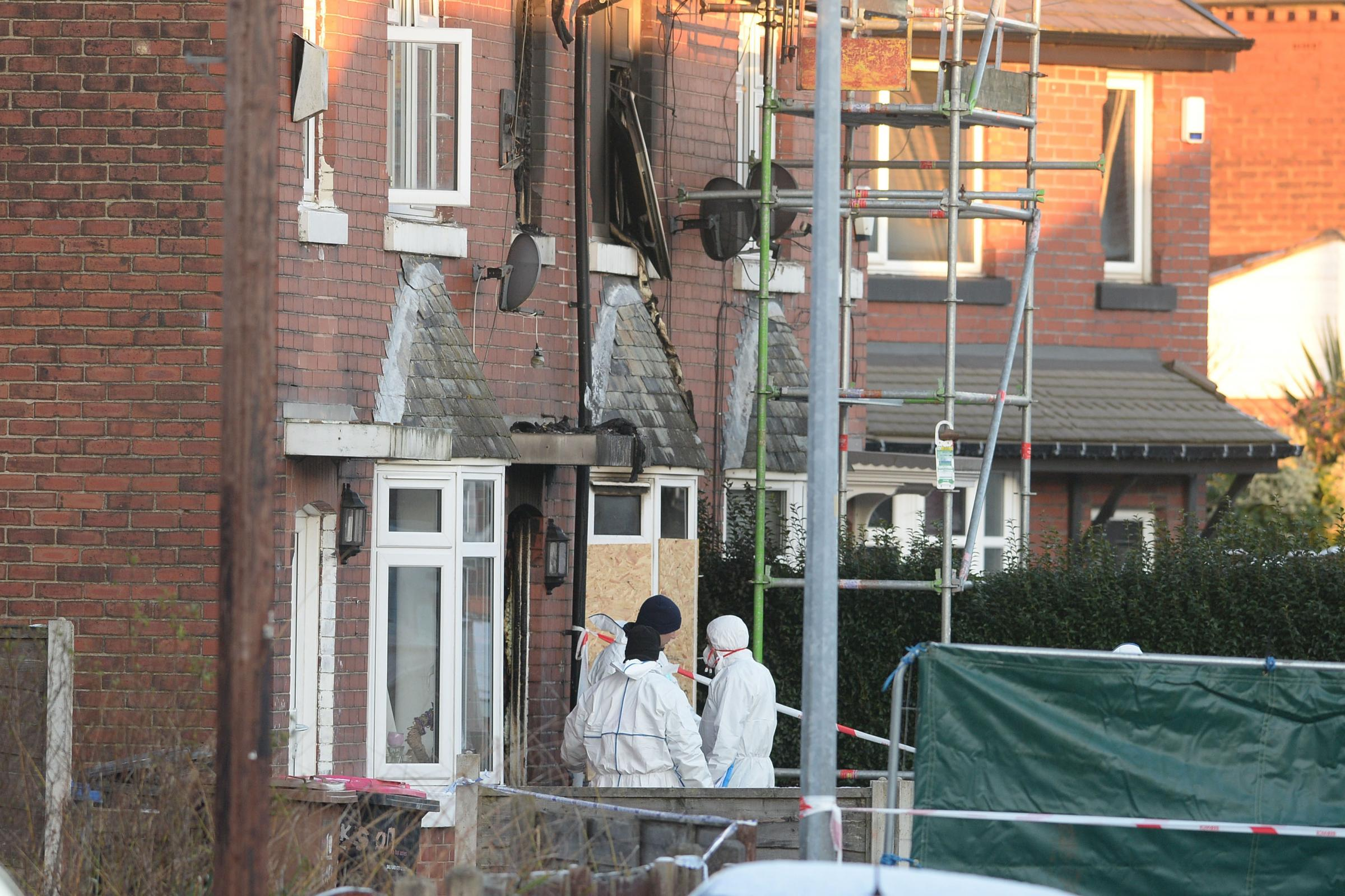 Forensic officers at the scene of a house fire on Jackson Street, Walkden, in which four children died (Peter Byrne/PA)