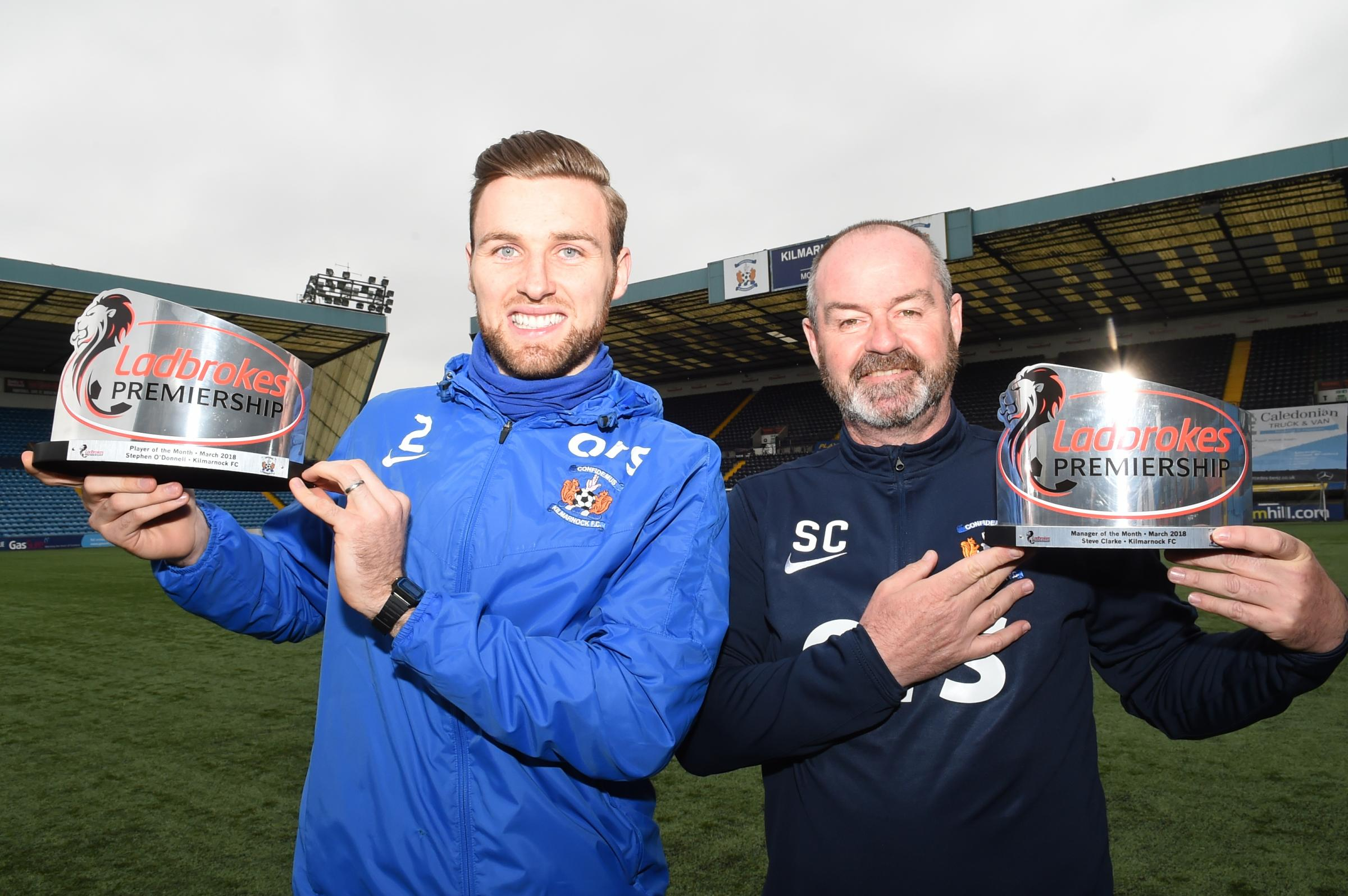 LEADING ACCOLADES: Steve Clark (right) and Stephen O'Donnell show off their awards.