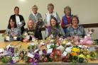 Flower club members with the small bouquets which were distributed in the Three Towns and West Kilbride last week.