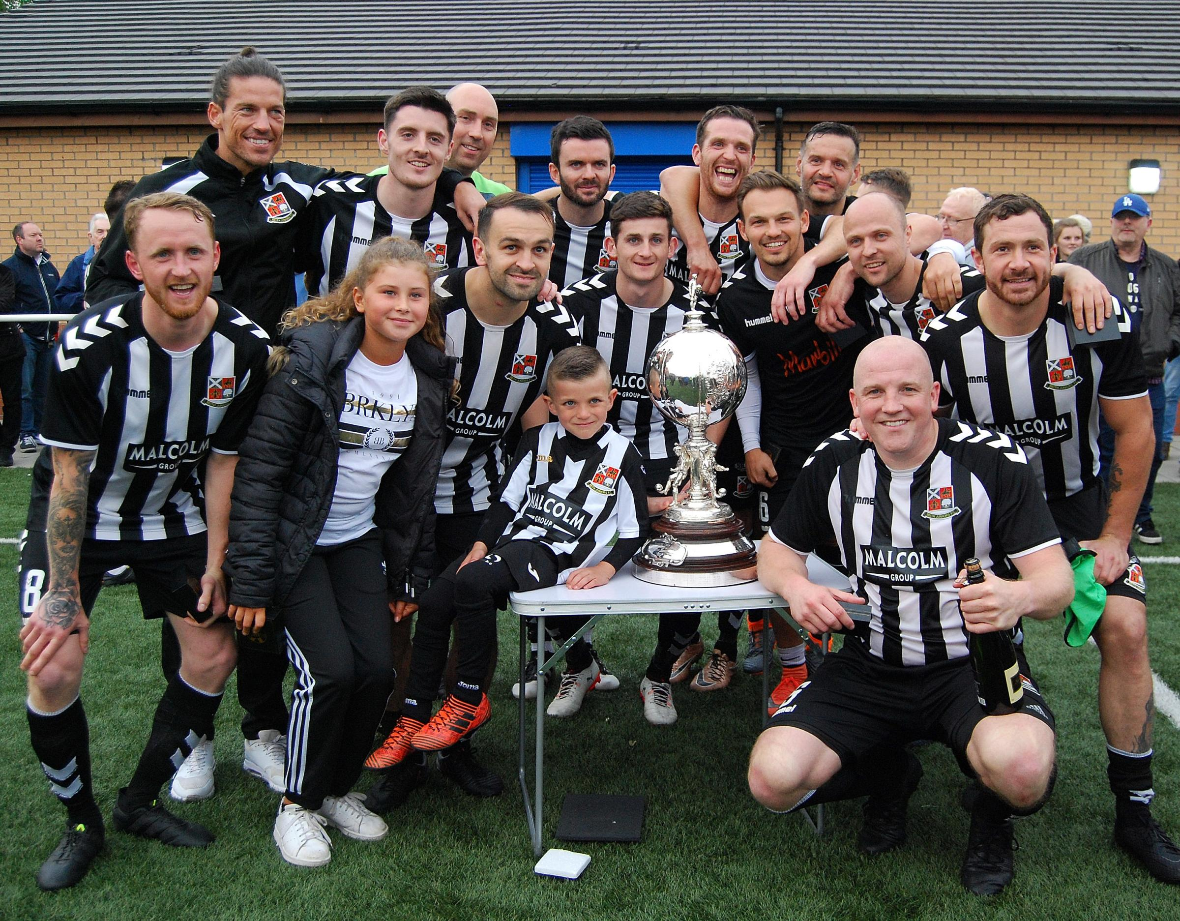 TROPHY DOUBLE: Beith Juniors celebrate their Evening Times Champions Cup success.