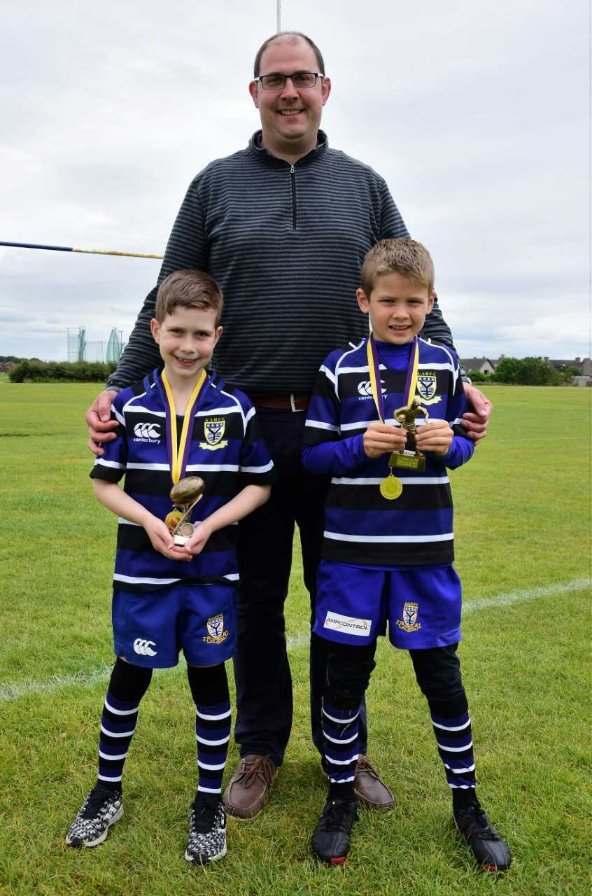 AWARD WINNER: P4's sportsman of the year Rory Smith (left) and player of the year Logan Murray (right) along with coach Dougie Tyler.