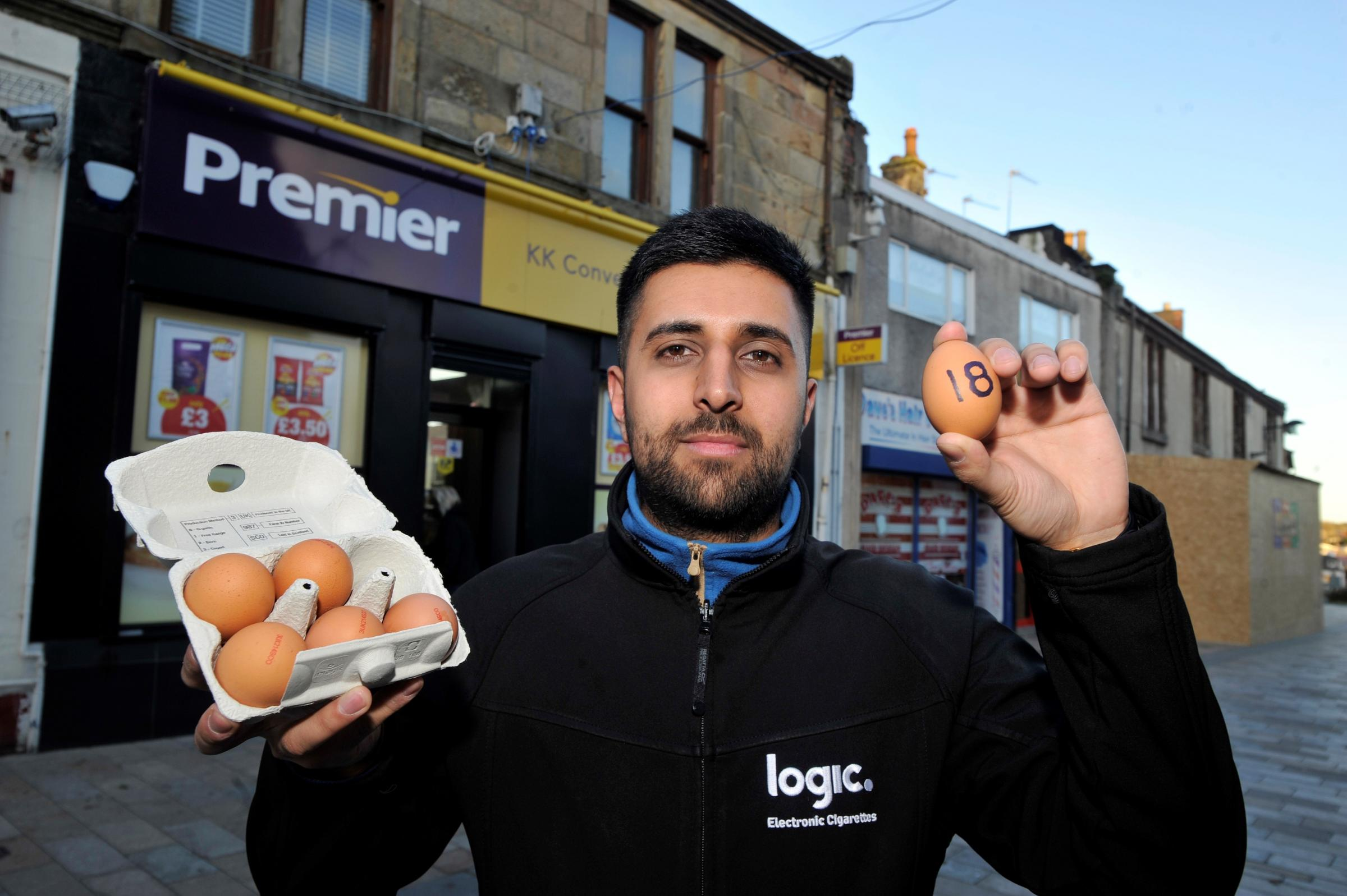 Sandeeop Dhaliwal with eggs outside his Kilwinning store.