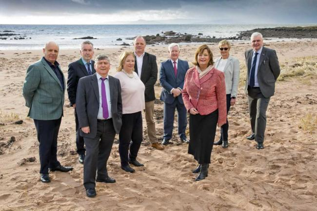 Fiona Hyslop on Seamill beach with council representatives and members of the business community.