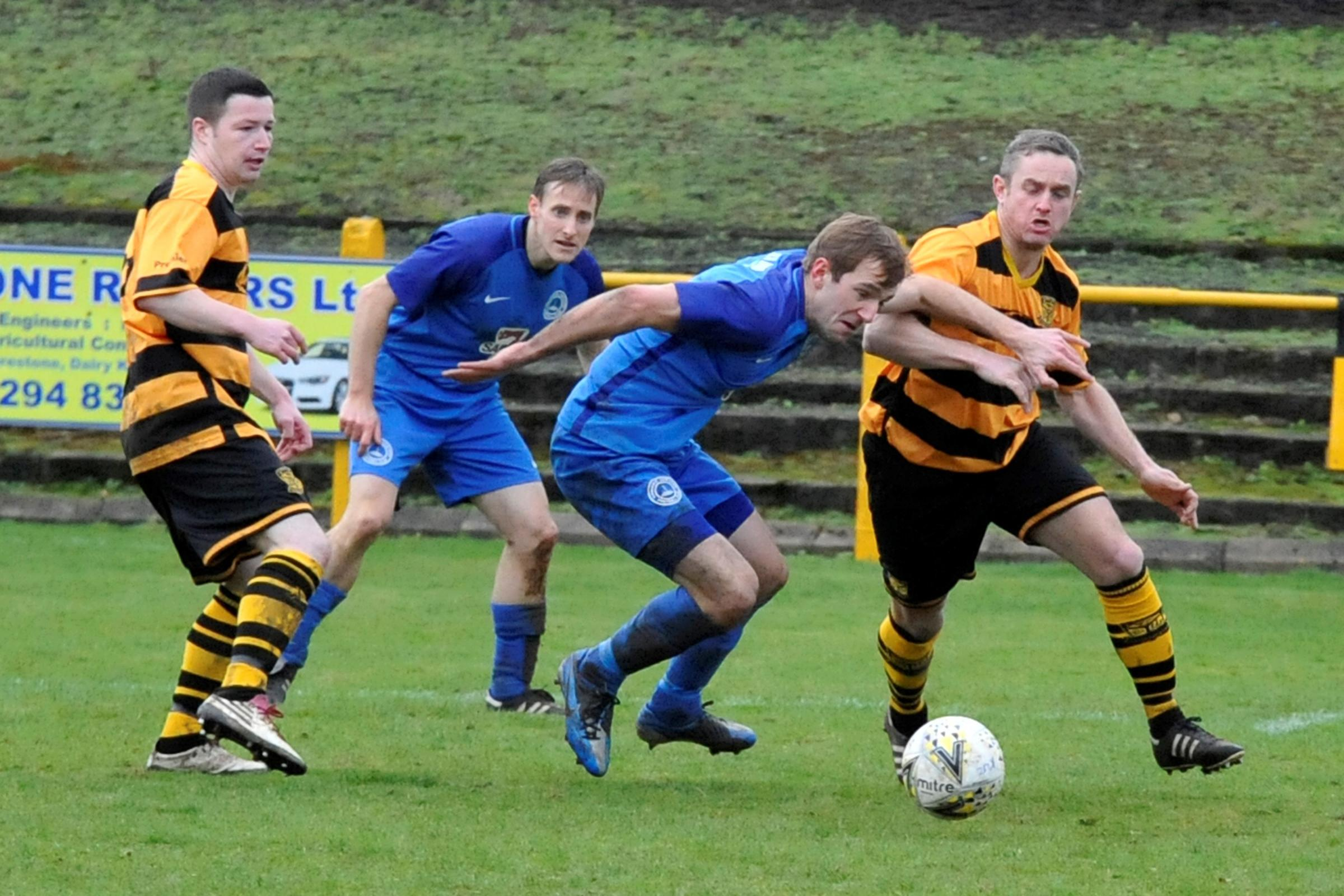 BATTLING HARD: Ladeside boss Liam McGuinness is pictured (right) in action against Cumnock.