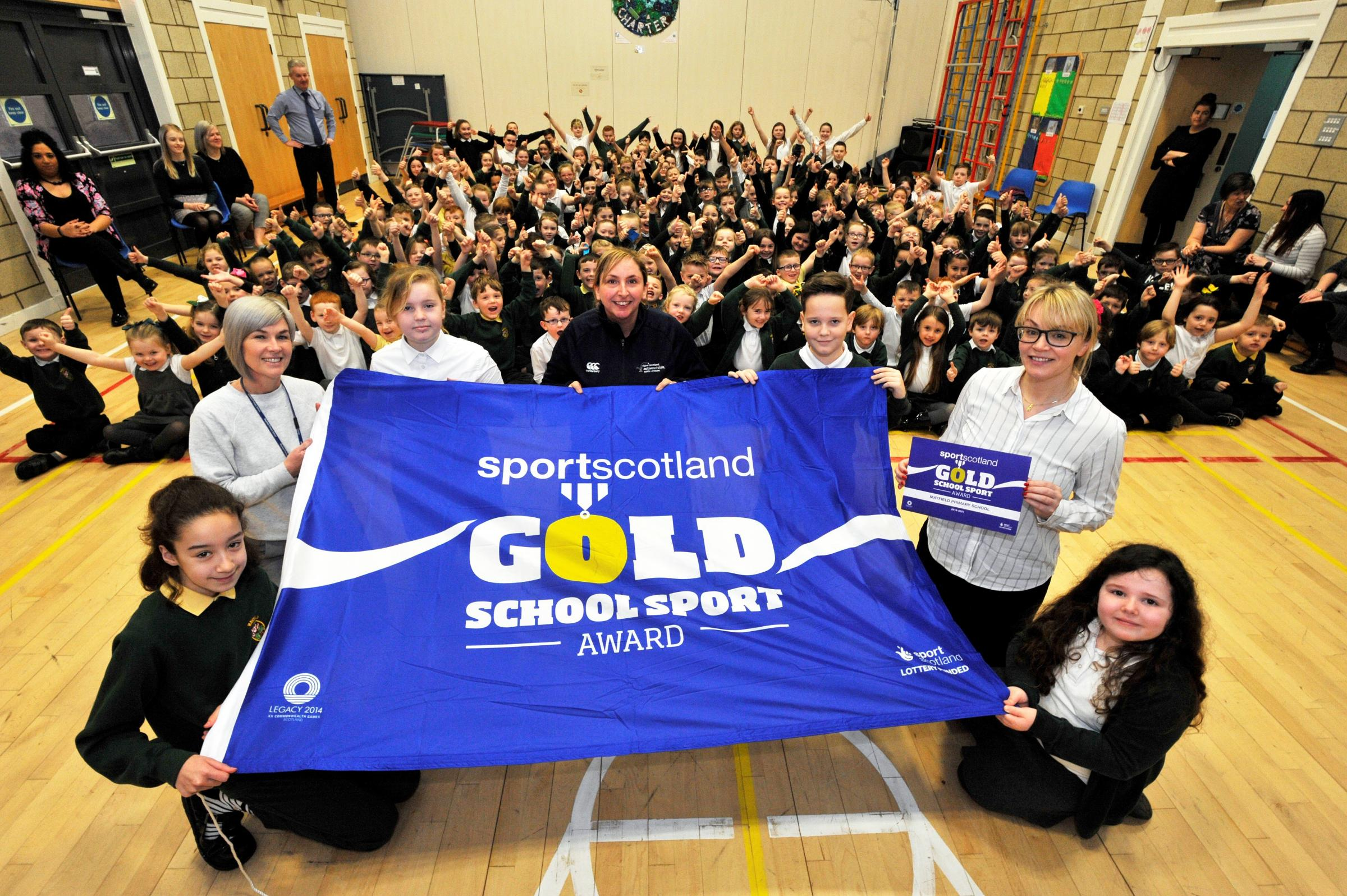 Gold sport flag at Mayfield primary school, Saltcoats. Clare Montgomerie, Leanne McPhail and Jane Leavey..