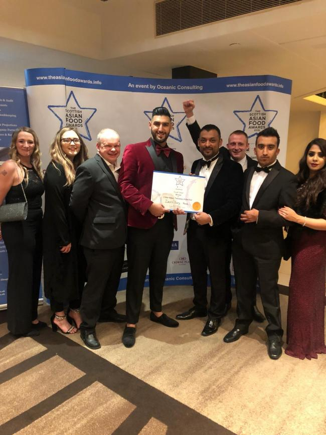 Zains staff after their win at the Scottish Asian Food Awards last year