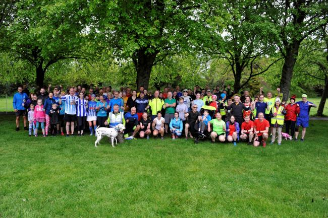 Parkrunners celebrate after raising money for a new defibrillator.